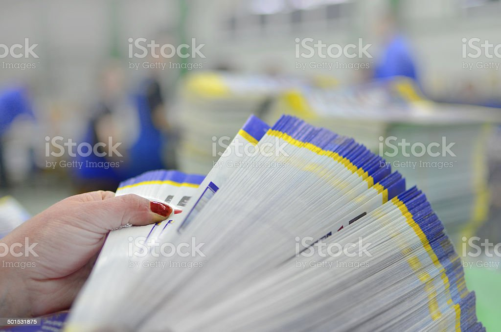 Manual controll and count of printed material packet stock photo