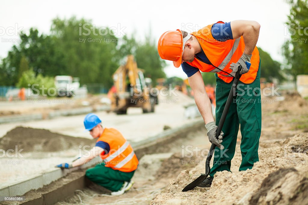 Manual labourer working stock photo