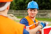 Manual lobourer wearing safety helmet