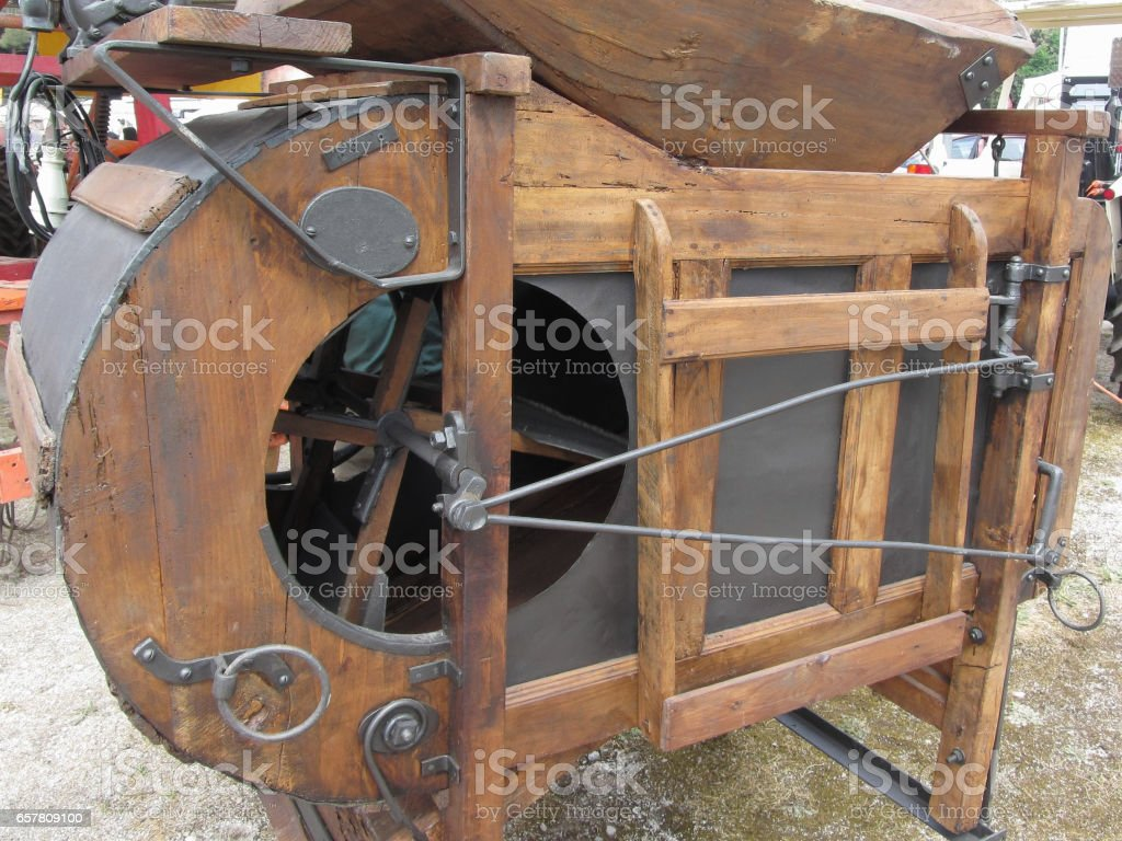 Manual machine used to shell the corn stock photo