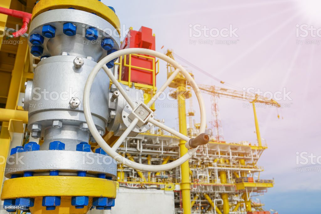 Manual operate ball valve at offshore oil and gas central processing platform. stock photo