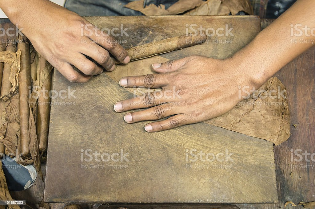 Manual production of cigars - Live preparation stock photo