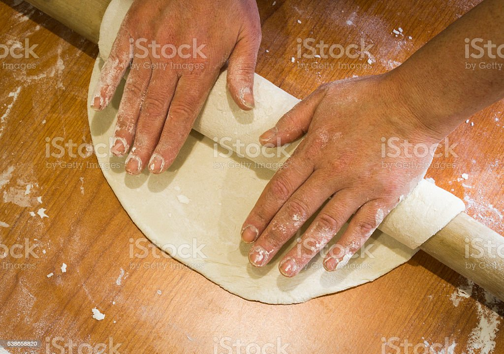 Manual rolling dough stock photo