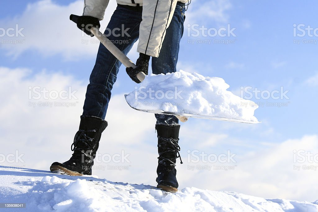 Manual snow removal stock photo