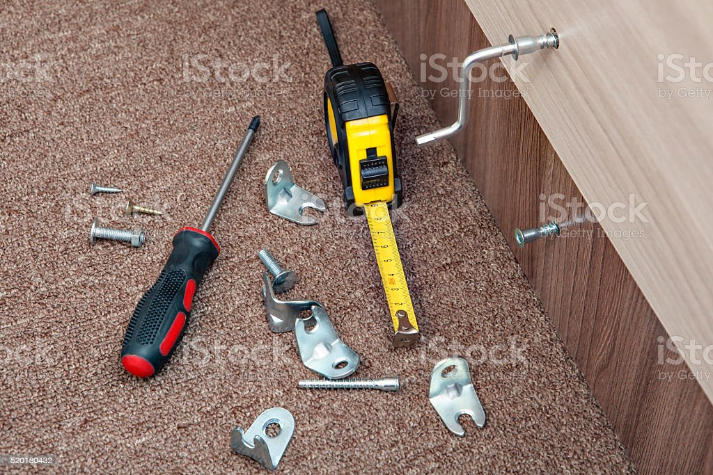Manual tool for assembly furniture, turn-screw, tape measure, fasteners, screw. stock photo