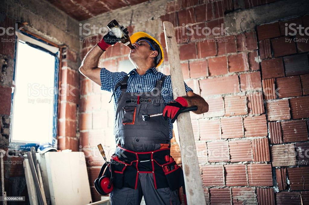 Manual worker drinking beer stock photo