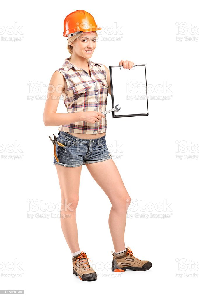 Manual worker holding a clipboard royalty-free stock photo