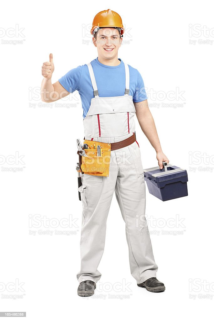 Manual worker holding a tool box and giving thumb up royalty-free stock photo