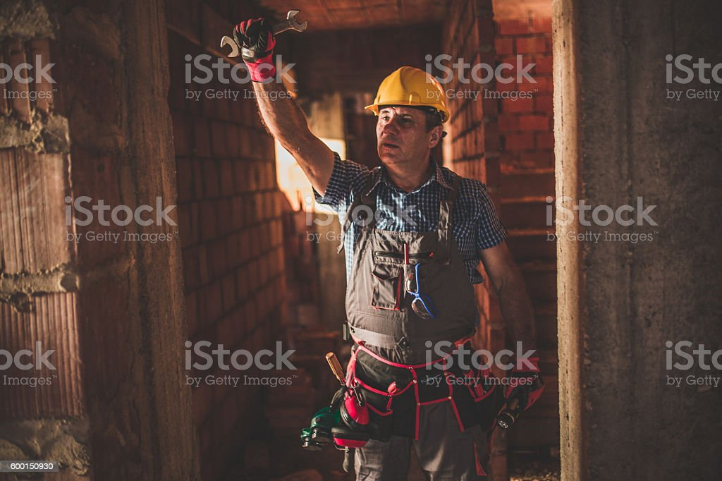 Manual worker holding a wrench stock photo