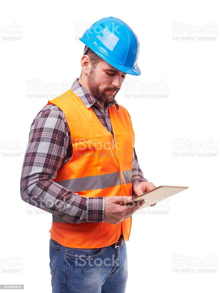 Manual worker in blue helmet stock photo