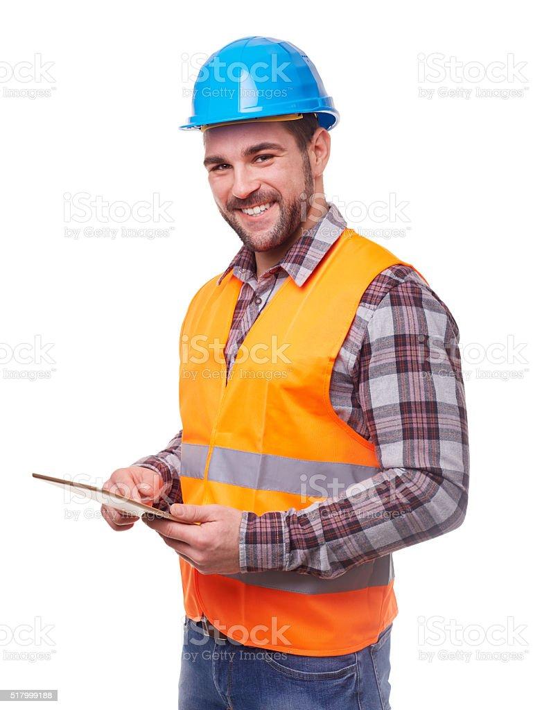 Manual worker in blue helmet using a digital tablet stock photo