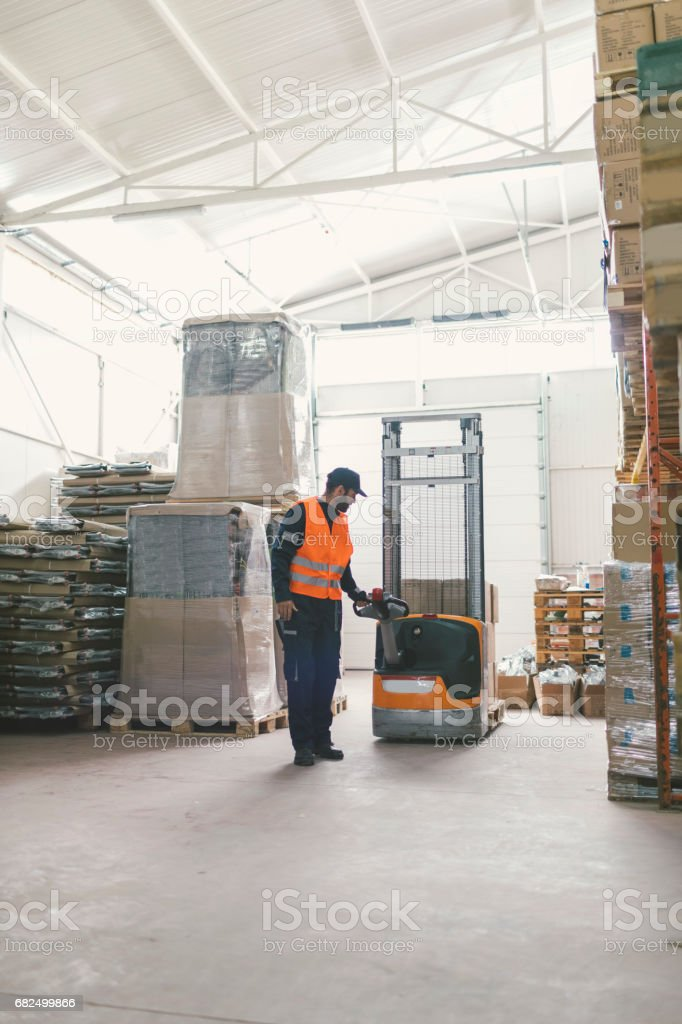Manual worker in warehouse stock photo