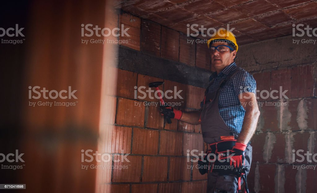 Manual worker indoors stock photo