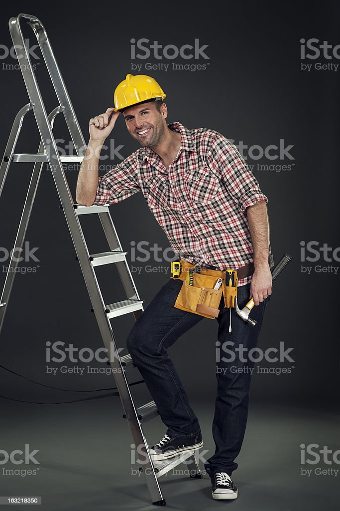 Manual worker leaning on the ladder royalty-free stock photo