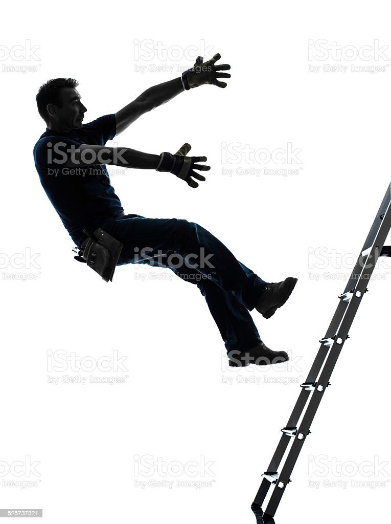 manual worker man falling from  ladder  silhouette stock photo