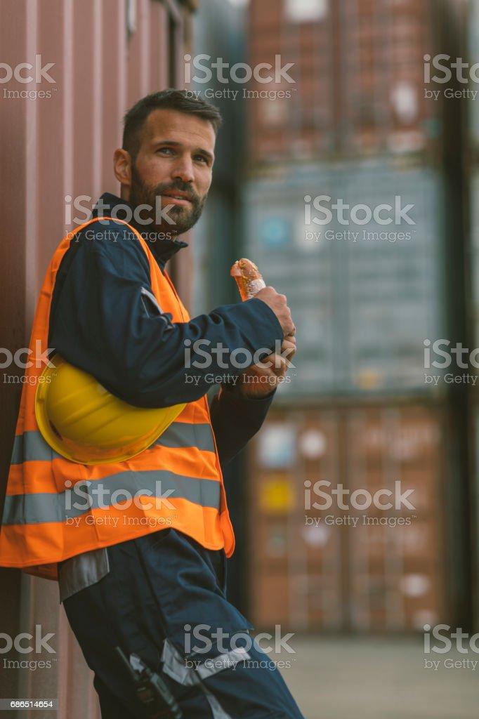 Manual worker on lunch break stock photo