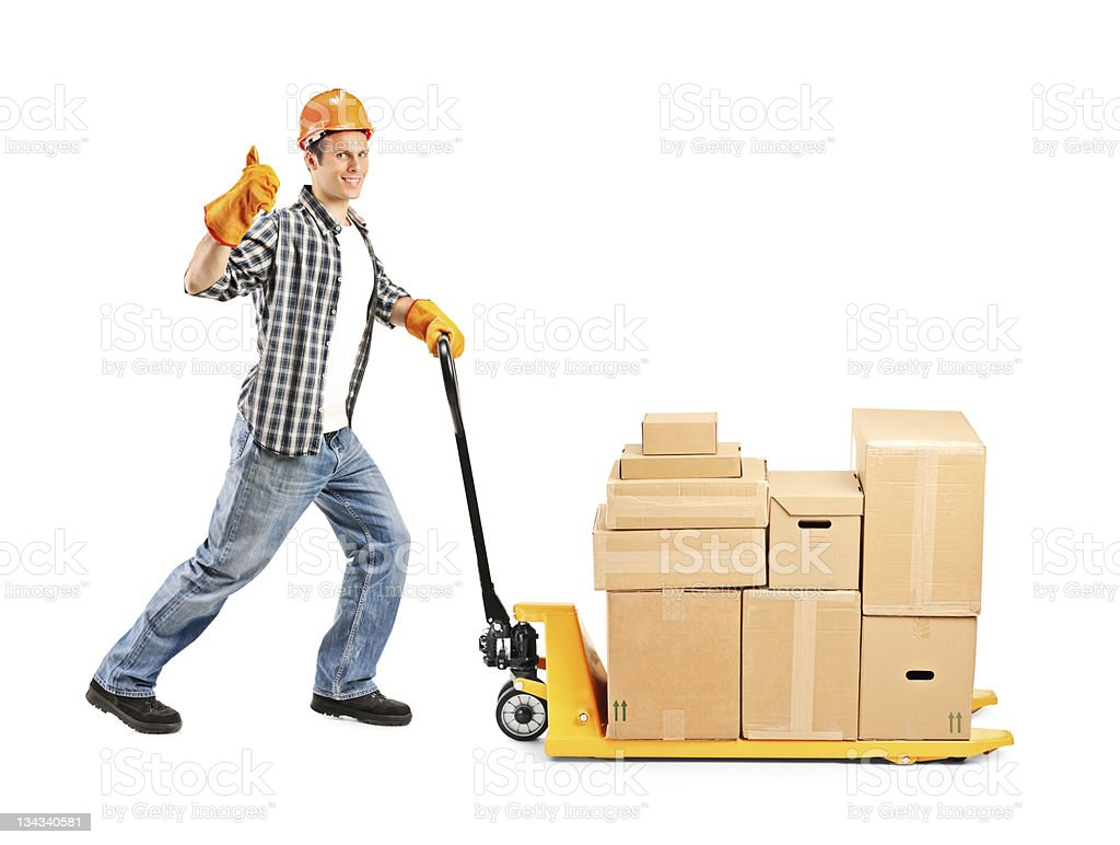 Manual worker pushing a fork pallet truck stacker stock photo