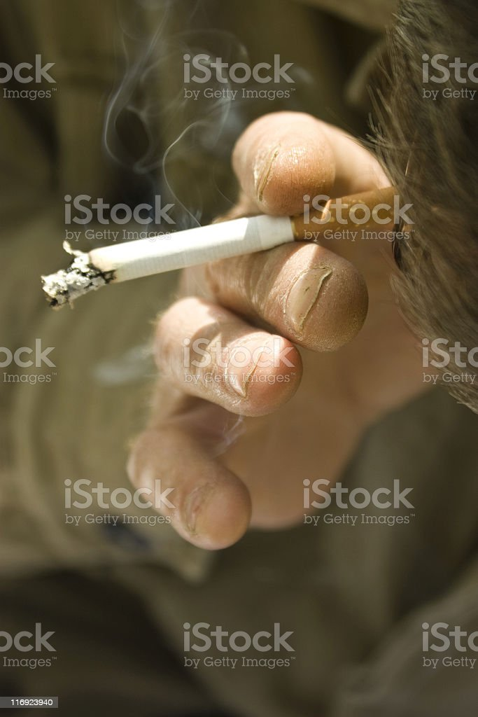 manual worker smoke keep cigarette in the hand royalty-free stock photo
