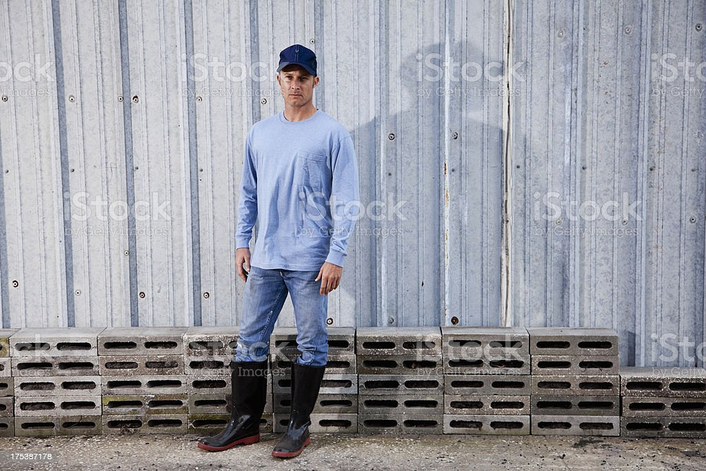 Manual worker standing outdoors stock photo