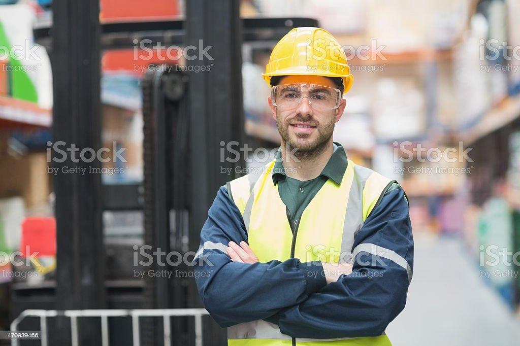 Manual worker wearing hardhat and eyewear stock photo