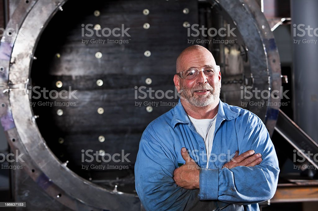 Manual worker wearing safety glasses stock photo