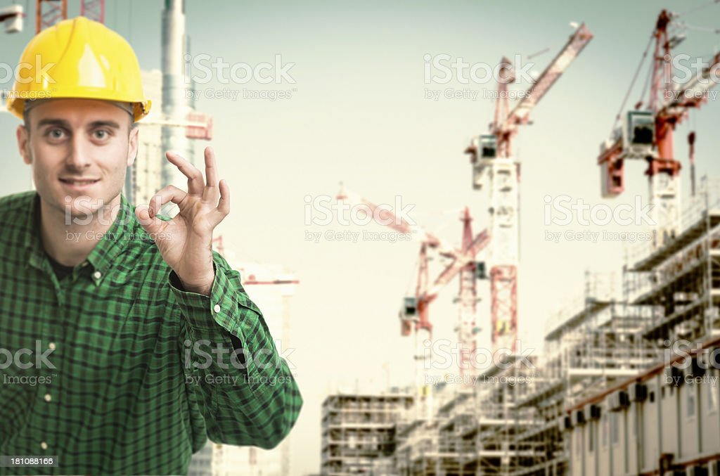 Manual worker with cran on the background royalty-free stock photo