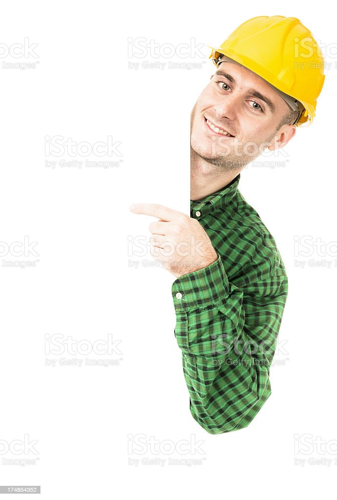 Manual worker with helmet aiming on blank billboard royalty-free stock photo