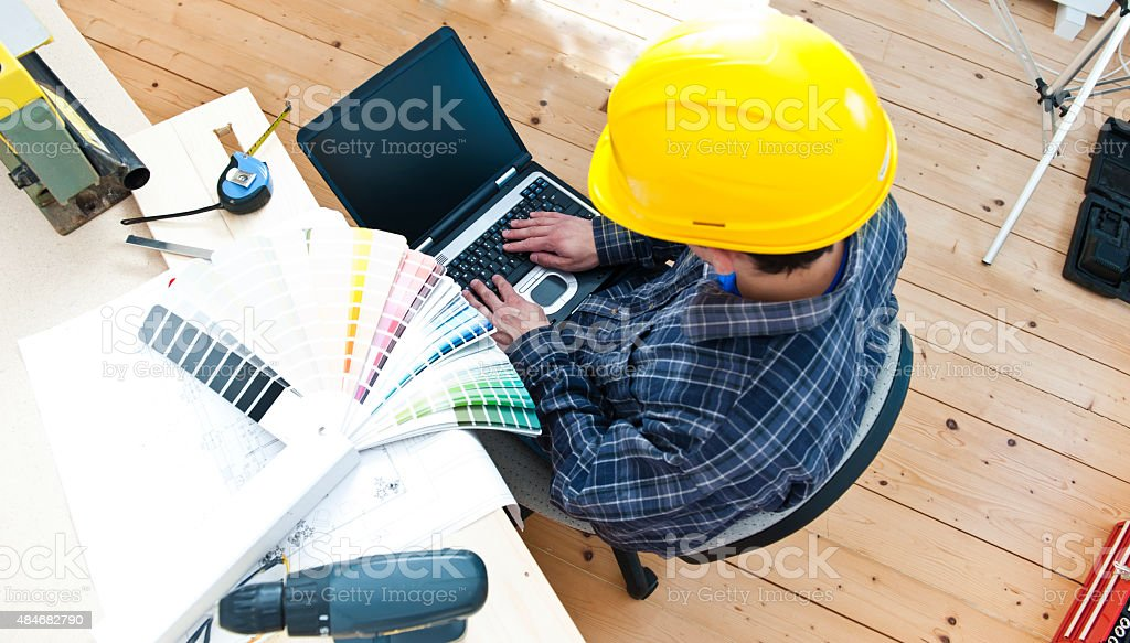 Manual Worker with laptop stock photo