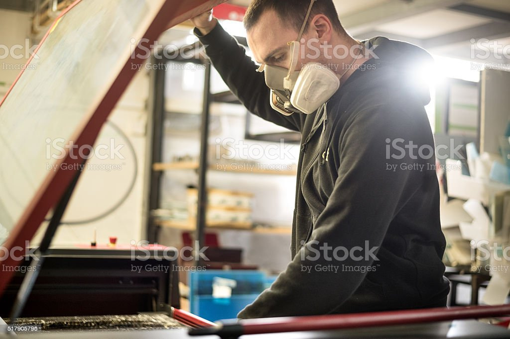 Manual worker with protective mask stock photo