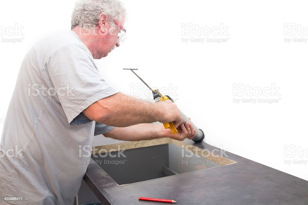 Manual worker with silicone gun stock photo