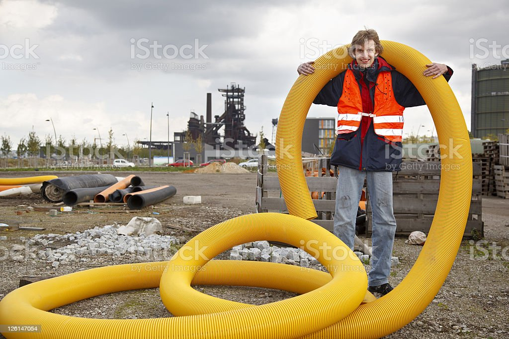 Manual Worker With Yellow Tube stock photo