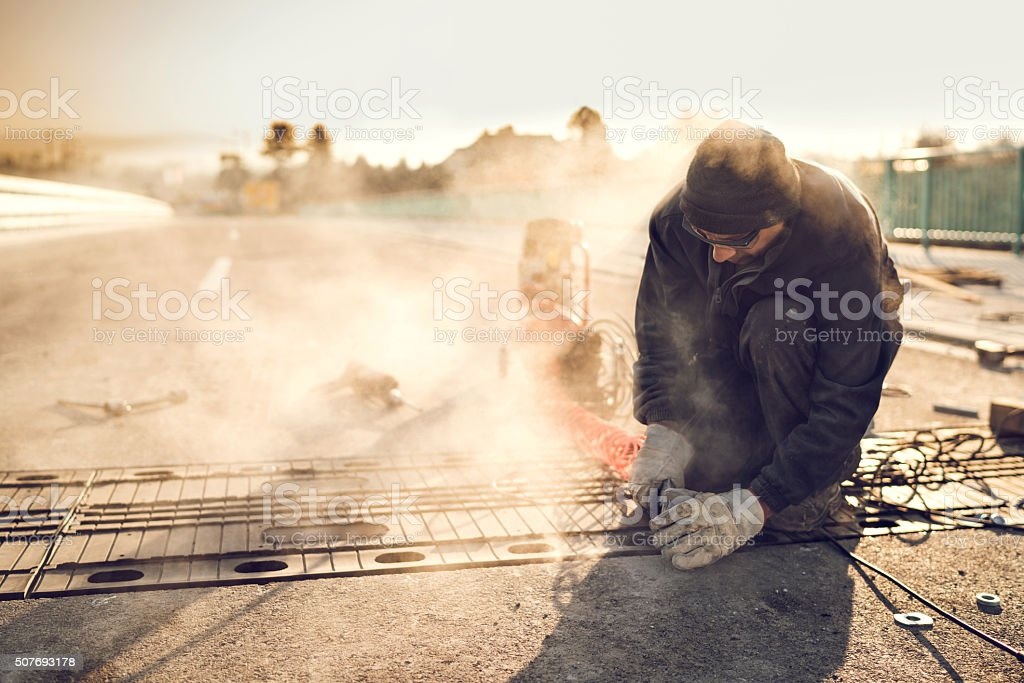 Manual worker working on road reparation. stock photo