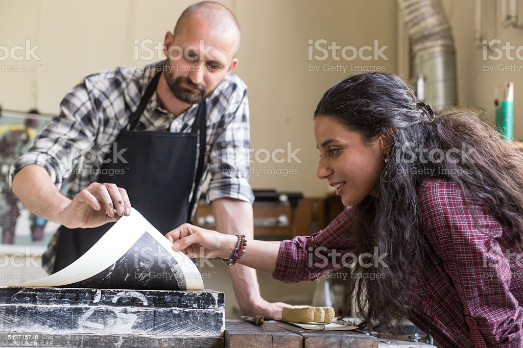 Manual workers finishing the lithography process stock photo