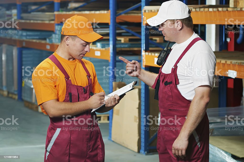 manual workers in warehouse stock photo