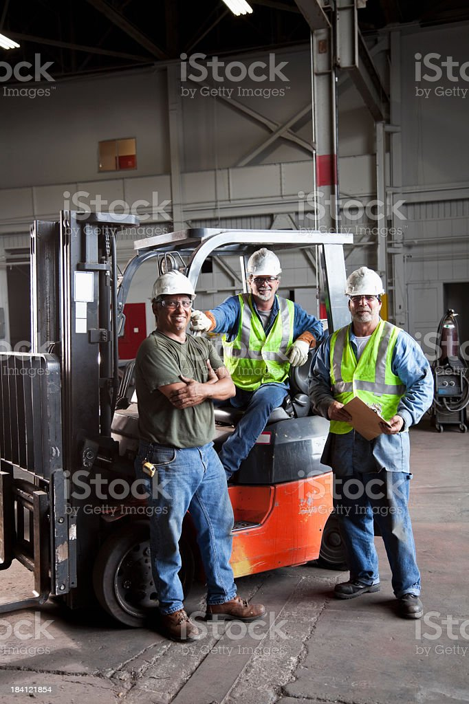 Manual workers in warehouse royalty-free stock photo