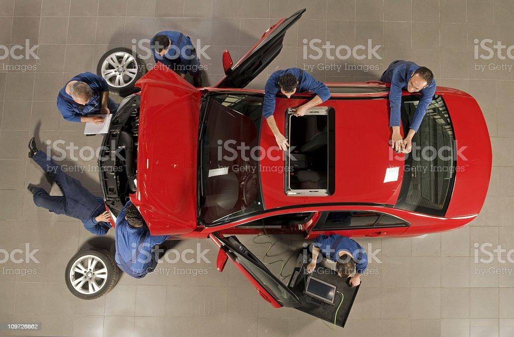 manual workers reparing the car royalty-free stock photo