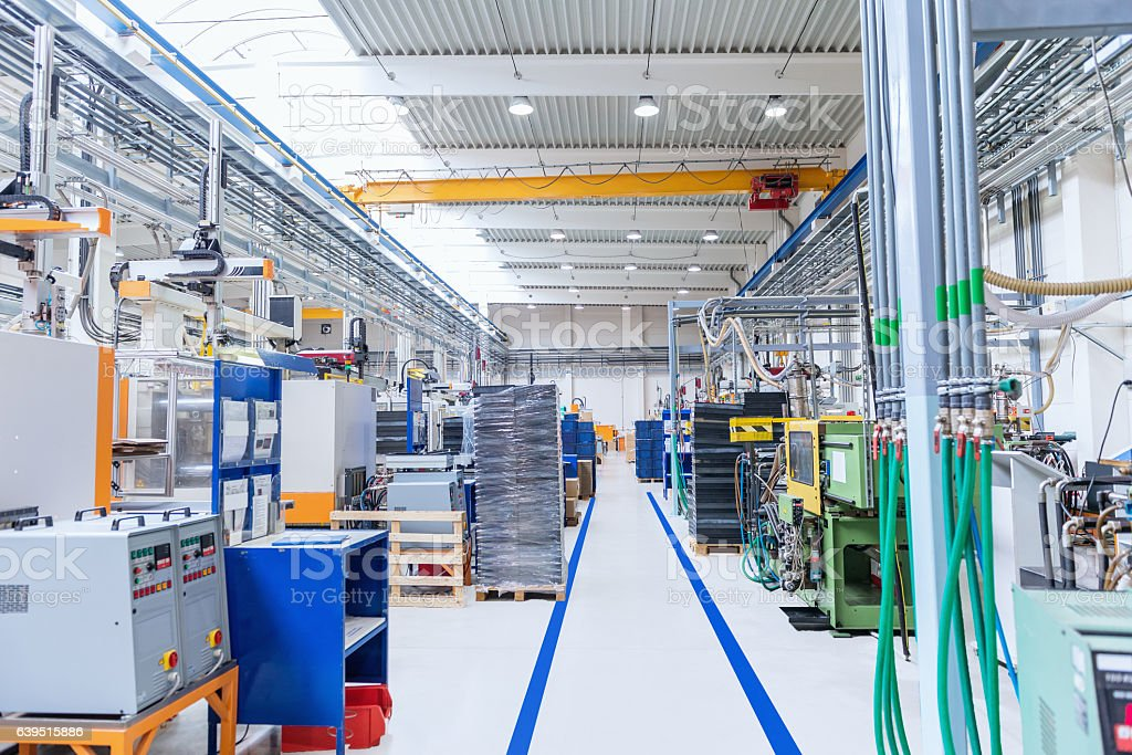 Manufacturing corridor in large factory stock photo