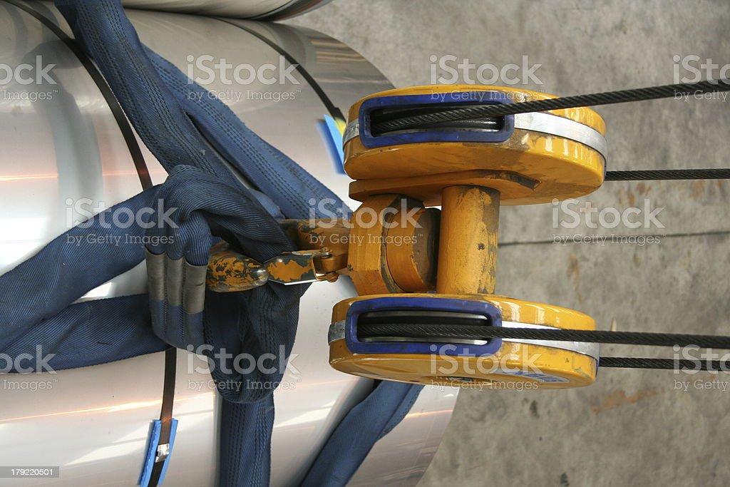 manufacturing crane lifting large metal tube royalty-free stock photo