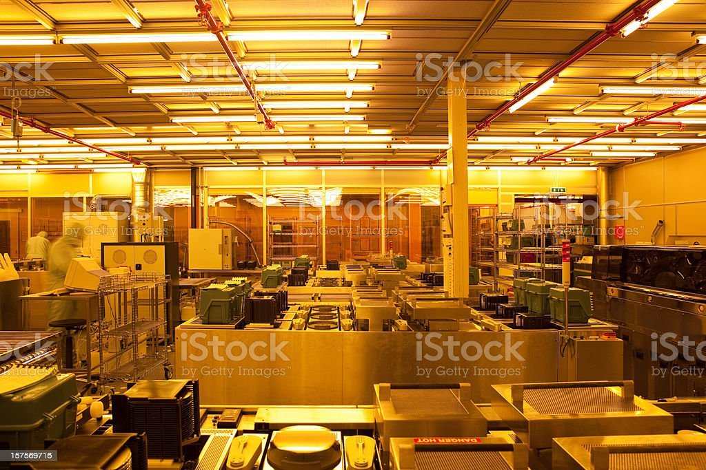 Manufacturing process - wafers and computer chips stock photo