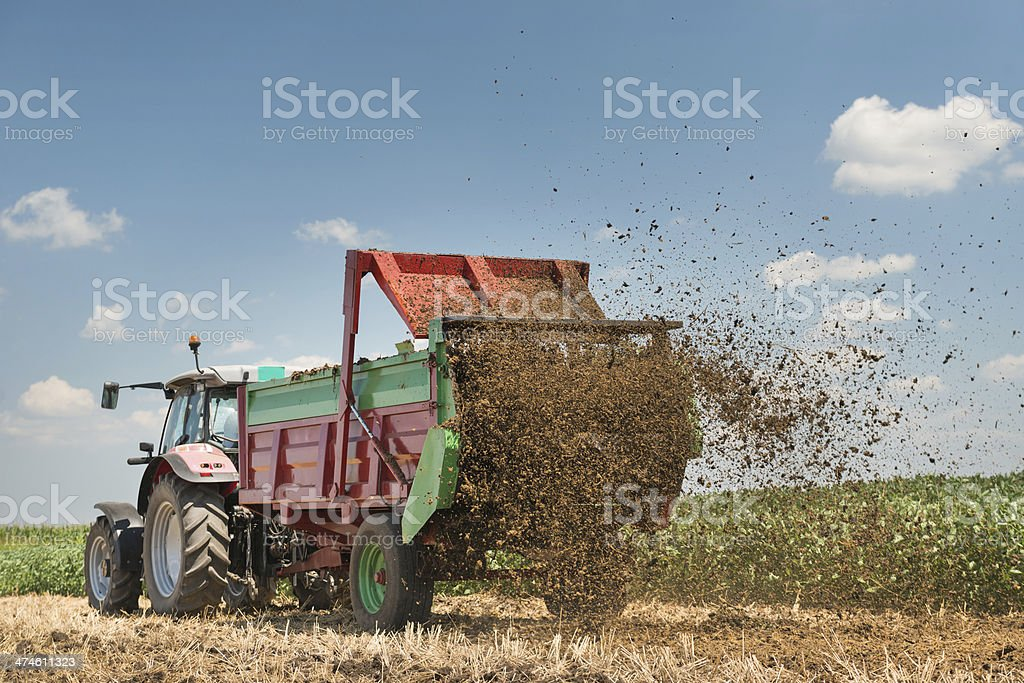 Manure spreader working stock photo