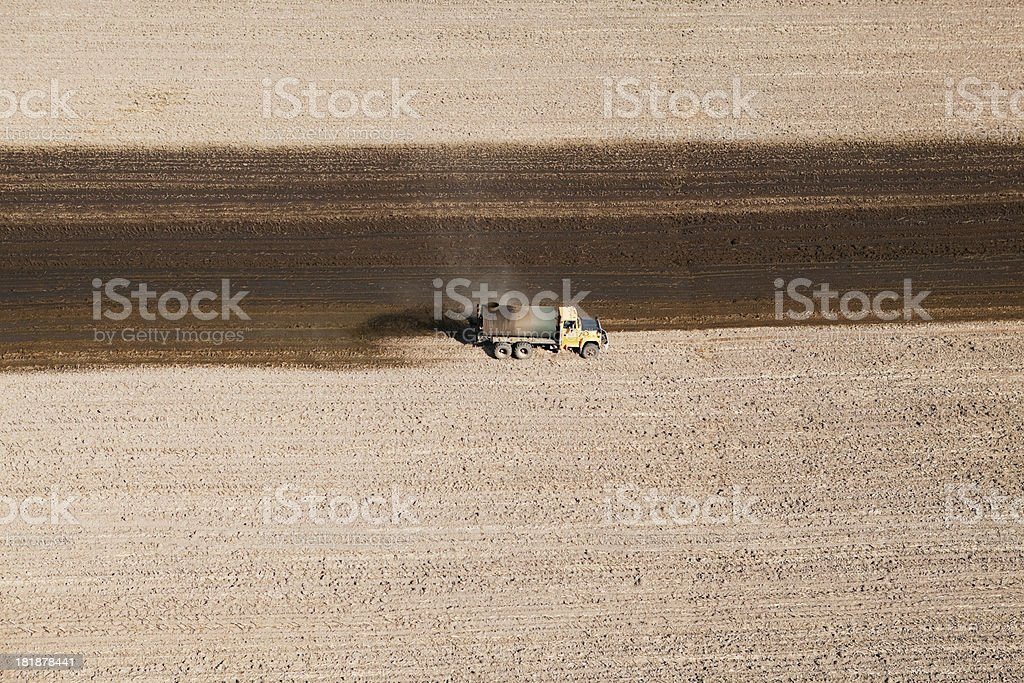 Manure Spreading on Harvested Cornfield Aerial royalty-free stock photo