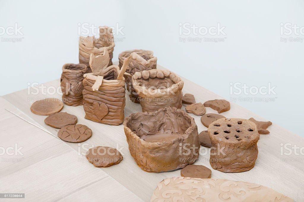 Many amateur handmade unbaked clay moldings stock photo
