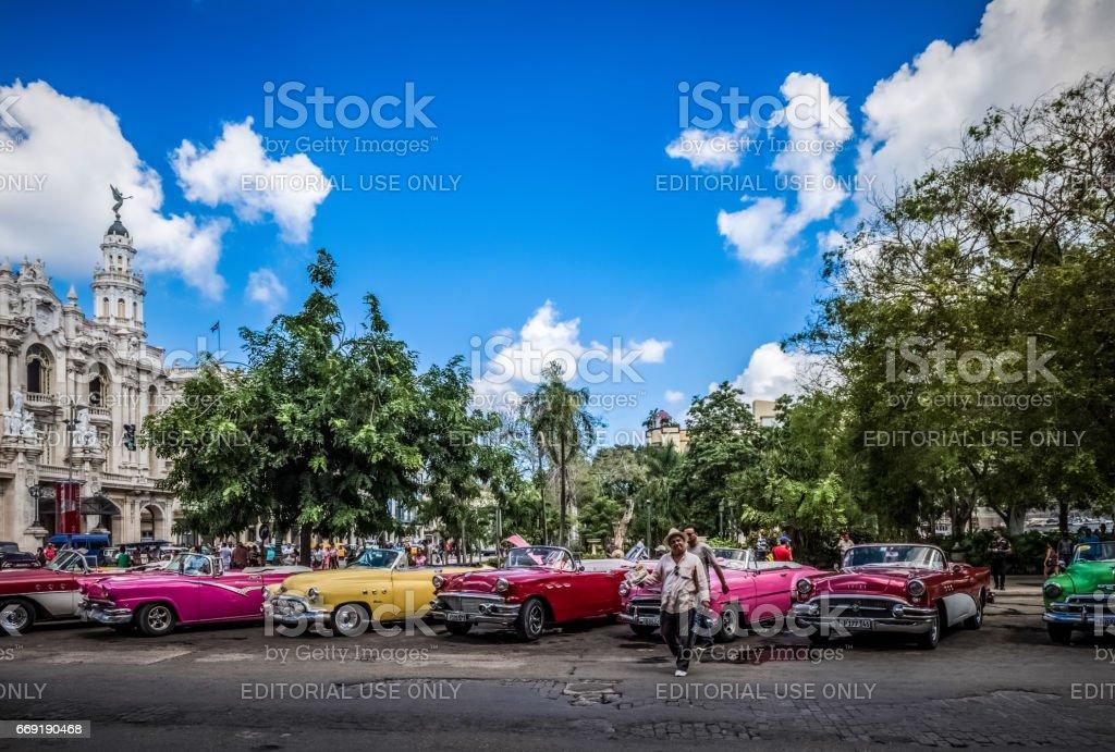 Many american convertible vintage cars before the gran teatro in Havana Cuba stock photo