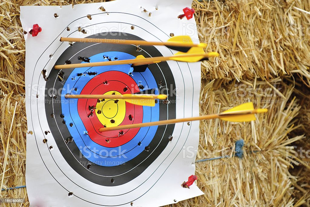 Many Arrows Stuck in an Archery Target stock photo