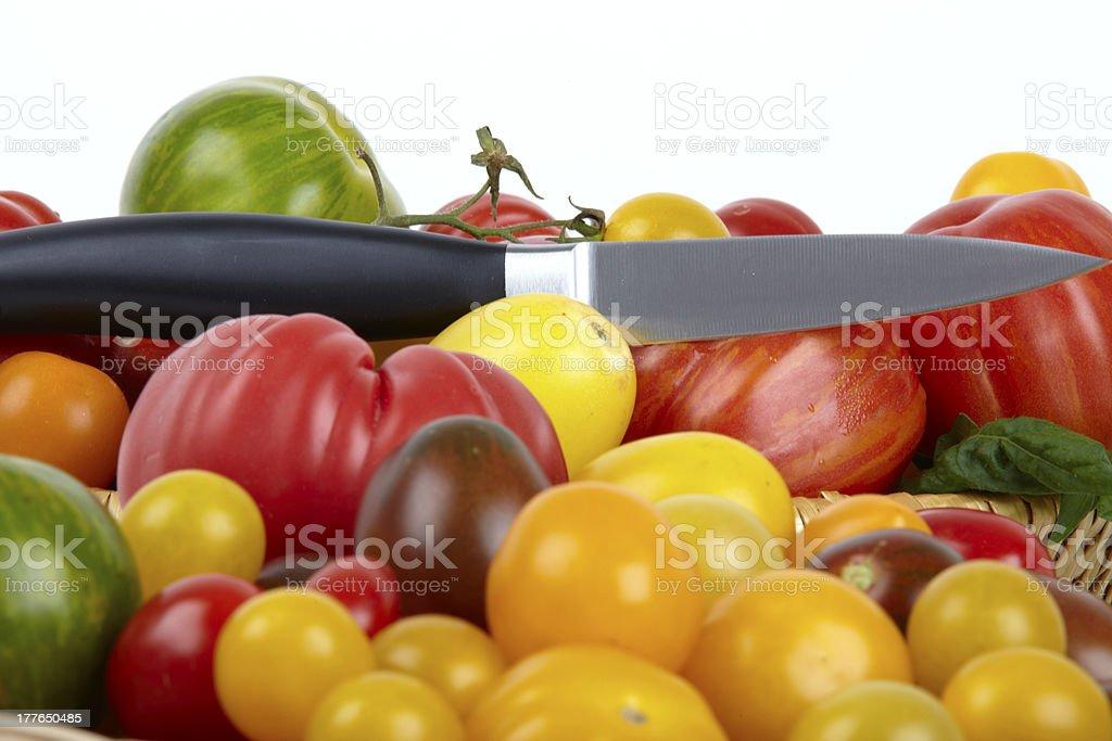 Many Assorted fresh organic tomatoes stock photo