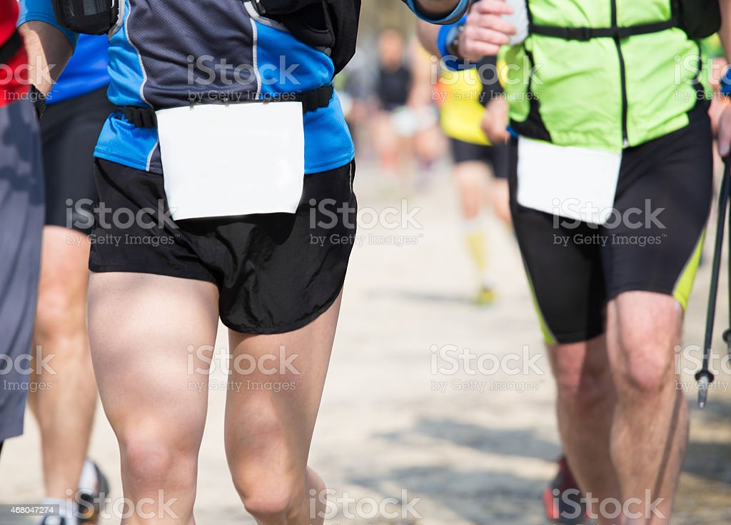 many athletes run in the outdoor race on the road stock photo