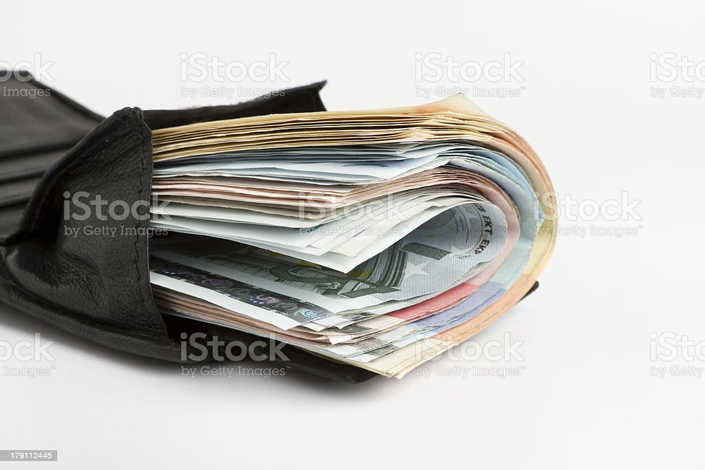 many banknotes in wallet stock photo