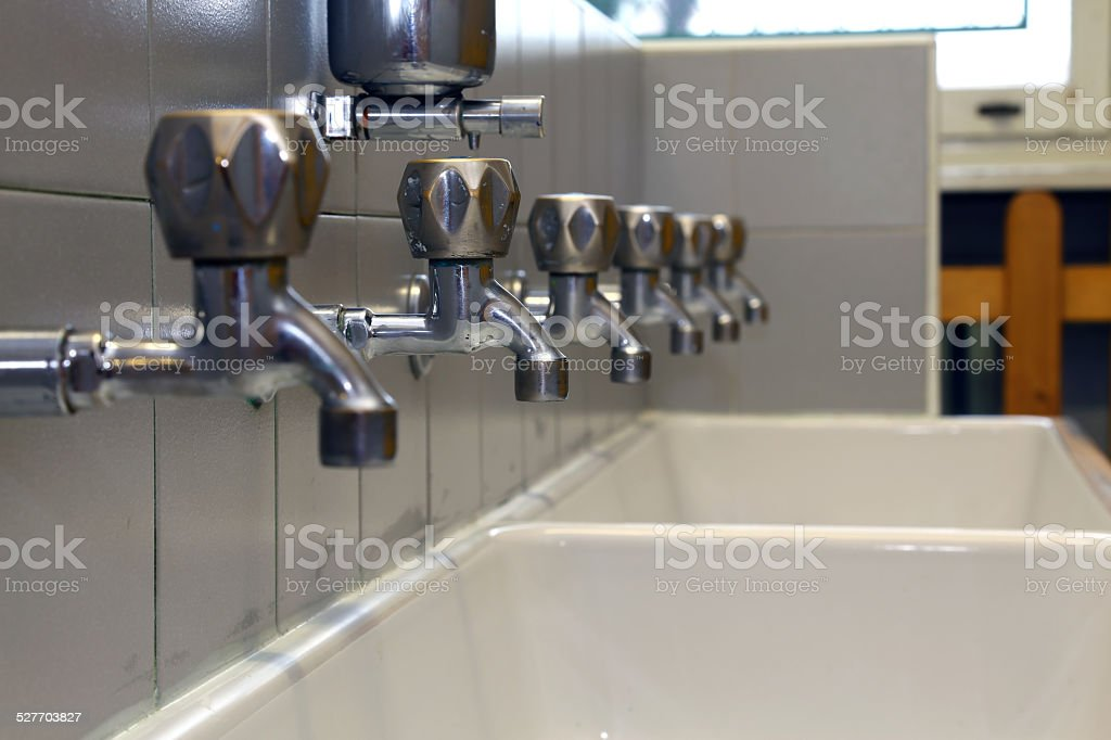 many Bath Taps of a nursery for children stock photo