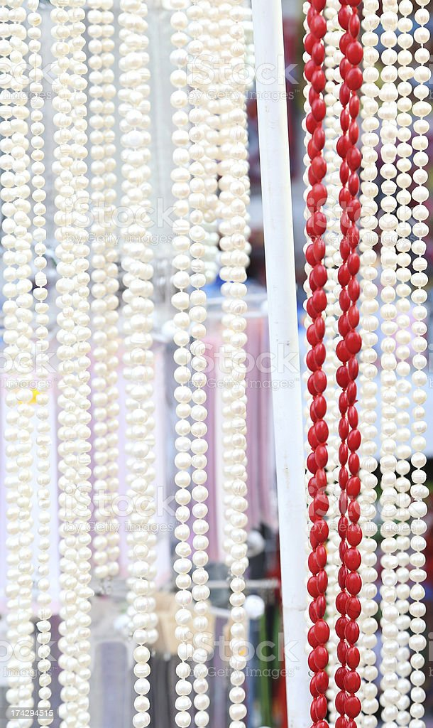 Many beads of pearls and corals. Close-up. royalty-free stock photo
