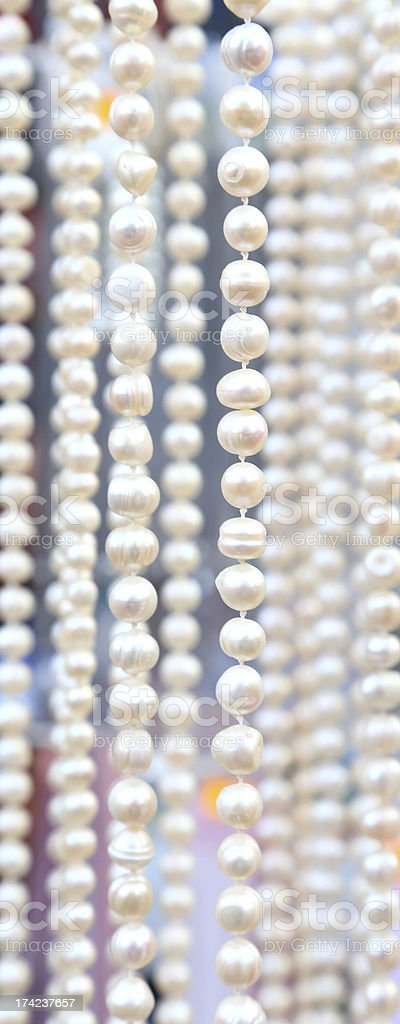 Many beads of pearls as ackground. Close-up. royalty-free stock photo